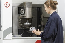 Woman working with grinding machine